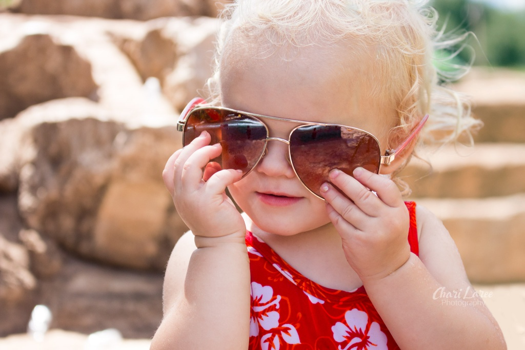 Baby at the beach with sunglasses on