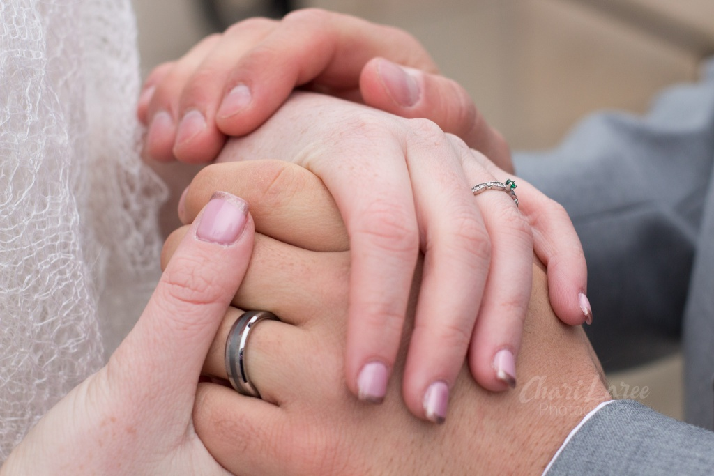 green wedding ring hand holding