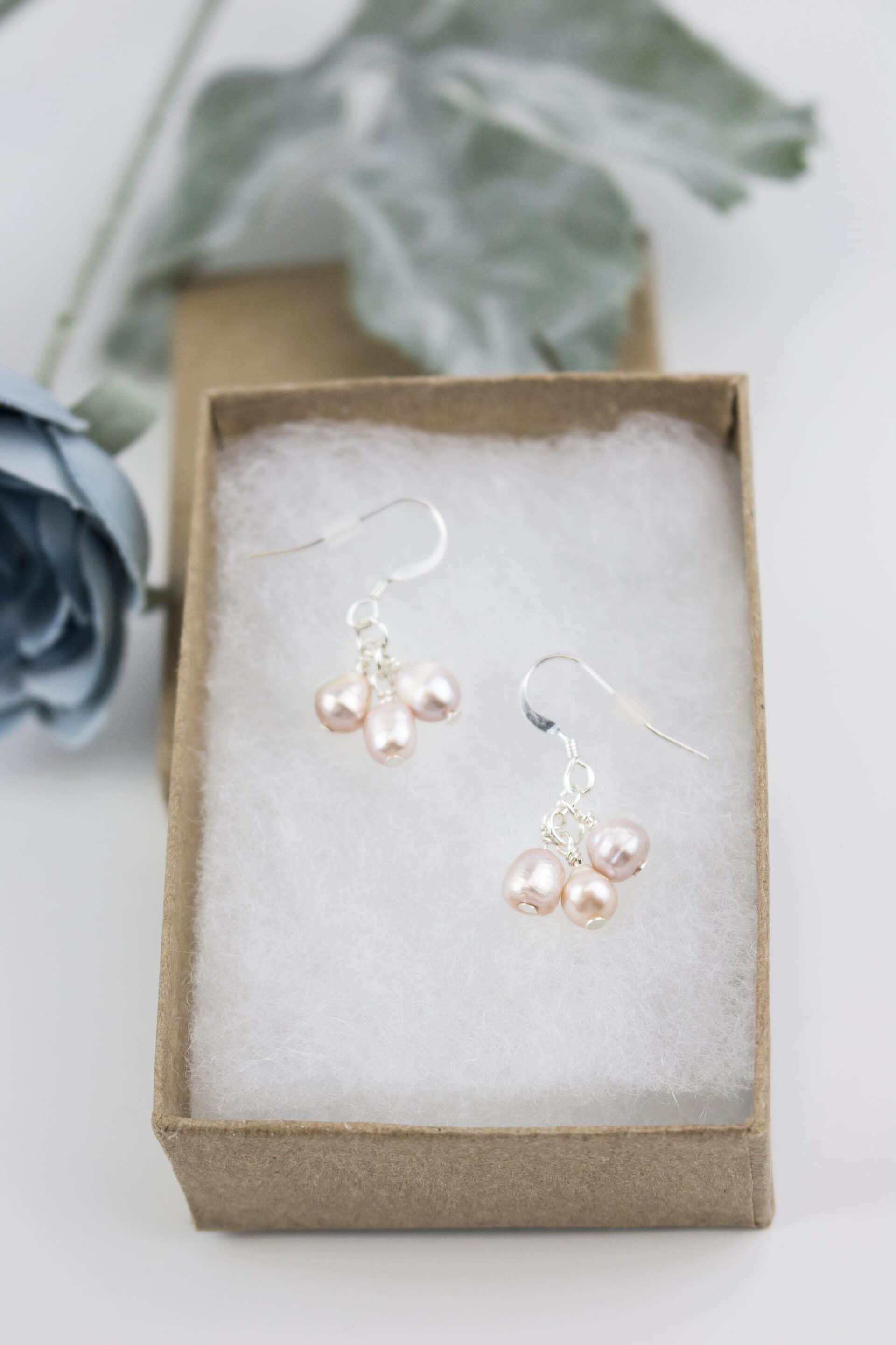 Chari Laree Photography Earrings In A Box With A Blue Flower